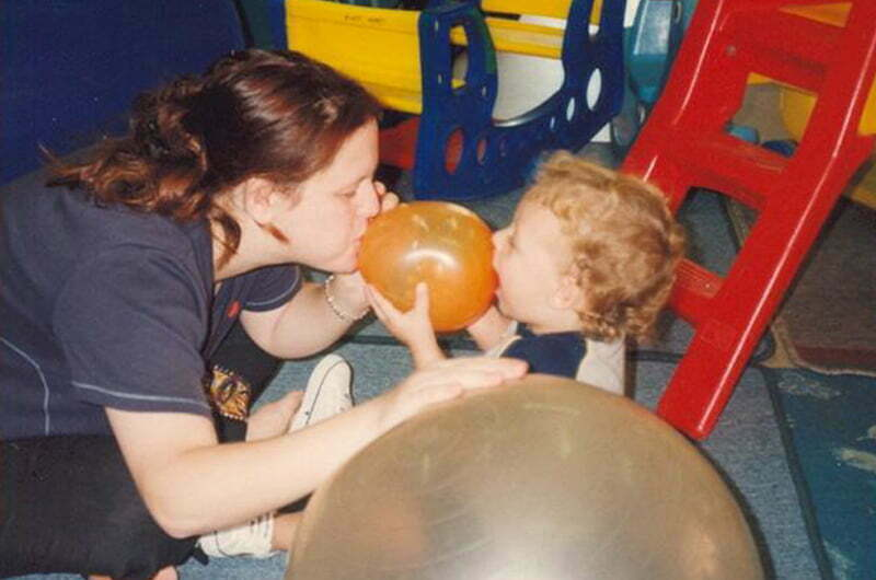 child plays with baloon